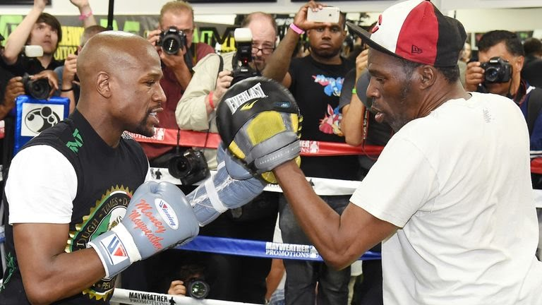 Roger Mayweather (right) guided his nephew Floyd for much of his unbeaten run over 50 fights
