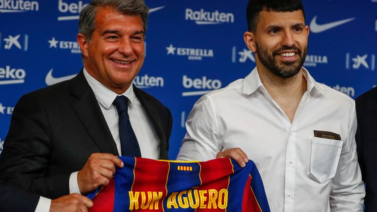 FC Barcelona president Joan Laporta, left, and Argentinian forward Sergio 'Kun' Aguero pose for the media during the official presentation of Aguero after signing for FC Barcelona in Barcelona, Spain, Monday May. 31, 2021. (AP Photo/Joan Monfort)